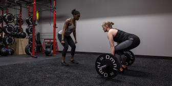 Women working with a personal trainer